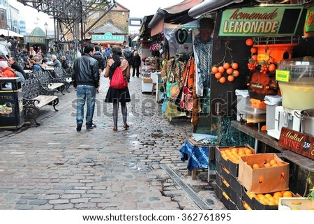 LONDON, UK - MAY 15, 2012: People visit shops in Camden Town, London. According to TripAdvisor, Camden Town currently is one of top 10 shopping destinations in London. - stock photo