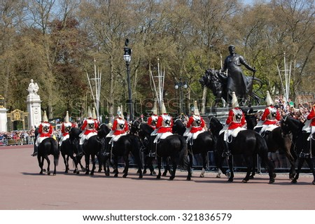 LONDON, UK - MAY 7: Queen's Life Guards riding on horse perform the Changing of the Guard in Buckingham Palace on May 7, 2013 in London, UK. - stock photo