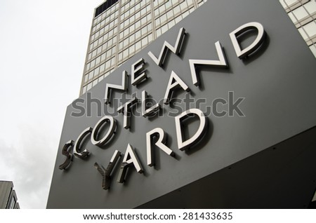 LONDON, UK - MAY 7, 2015:  Rotating sign outside the headquarters of London's Metropolitan Police in Westminster.  Senior officers in the force are based in this building. - stock photo