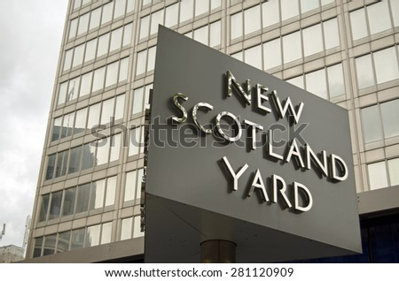LONDON, UK - MAY 7, 2015:  Sign outside the headquarters of London's Metropolitan Police in New Scotland Yard, Westminster.  The Commissioner and other senior officers are based here.