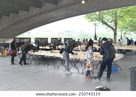 LONDON, UK - MAY 30, 2014: The Southbank Centre's Book Market is one of London's best kept secrets. Tucked under the Waterloo Bridge on Queen's Walk. - stock photo