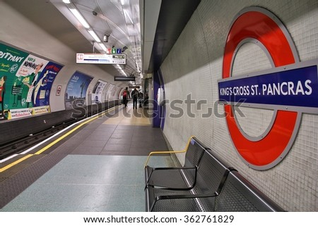 LONDON, UK - MAY 15, 2012: Travelers wait at King's Cross St. Pancras underground station in London. London Underground is the 11th busiest metro system worldwide with 1.1 billion annual rides. - stock photo