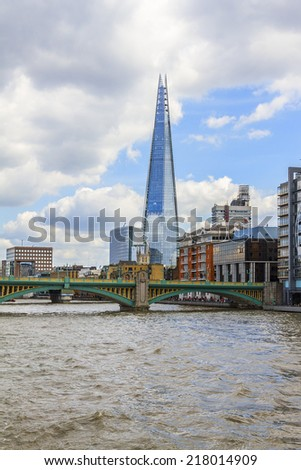 LONDON, UK - MAY 25, 2013: View from river of The Shard (Architect Renzo Piano, 2012) - tallest building in European Union. Glass-clad pyramidal tower (310 m) has 72 habitable floors.