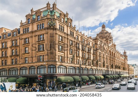 LONDON, UK - MAY 25,2013: View of famous department store Harrods (80,000 sq m) in London. First Harrods was opened at 1849 and now it is one of the most famous luxury store in London. - stock photo