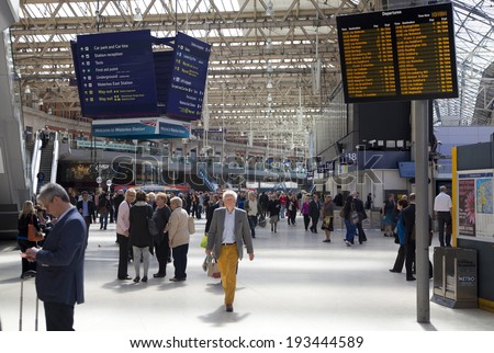 LONDON, UK - MAY 14, 2014  - Waterloo international station in the centre of London, one of the main rail junction of Great Britain  Departure hall with travelers - stock photo