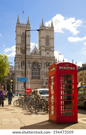LONDON, UK - MAY 14, 2014: Westminster abbey and famous English red telephone box - stock photo