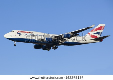 LONDON, UK - NOV 10: A British Airways aircraft approaching Heathrow airport on Nov 10, 2013 in London, UK. Heathrow unveils a new third runway option to solve the lack of hub airport capacity in UK. - stock photo