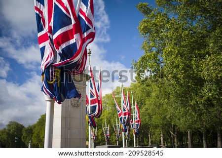 LONDON, UK - NOV 6: National flags are used for decoration of the Mall and Buckingham Palace on November 6, 2013 in London, UK.  - stock photo