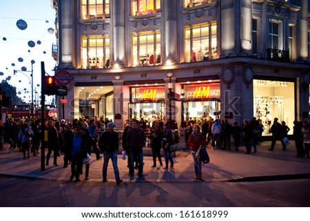 LONDON, UK - NOV 2: People stroll in Oxford Circus in London on November 2, 2013. The intersection between Oxford Street and Regent's Street is the main shopping center within Inner London. - stock photo