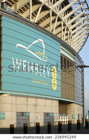 LONDON, UK - NOVEMBER 28, 2014: A detail of the exterior facade of the new Wembley stadium with a billboard on November 28, 2014 in London / Wembley Stadium       - stock photo