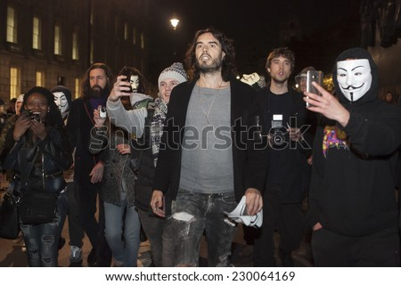 London UK - NOVEMBER 5 2014: Anonymous & Stop Mass  Network held Million Mask March that started in Trafalgar square. Russell Brand joins March as violence breaks out between police and protesters - stock photo