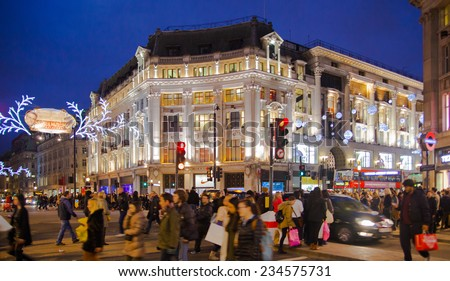 LONDON, UK - NOVEMBER 30, 2014: Black Friday weekend in London the first sale before Christmas. Regent street beautifully decorated with Christmas lights. Roads were open for pedestrians only  - stock photo