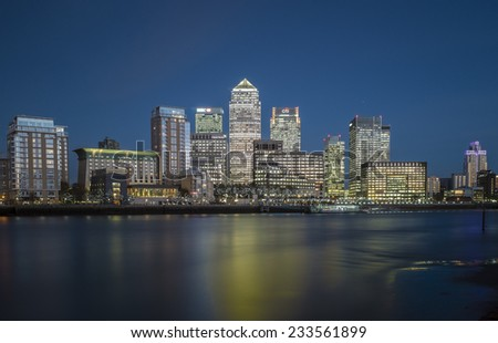 LONDON, UK - NOVEMBER 7 2014 - Early evening view of Canary Wharf London taken from the opposite side of the river Thames - stock photo