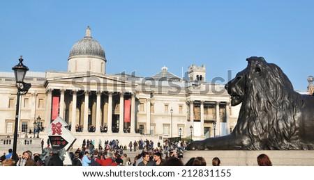 LONDON, UK - NOVEMBER 18, 2011: Group of tourists visit the National Gallery in Trafalgar Square, London.  - stock photo