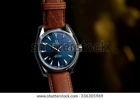 London, UK - 7 November 2015: Omega Seamaster Aqua Terra mechanical swiss watch.  This watch has a blue dial and a light brown camel leather strap.