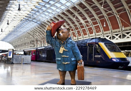 LONDON, UK - NOVEMBER 4TH 2014: A sculpture of Michael Bond's fictional children's character Paddington Bear - situated in Paddington Station in London on 4th November 2014. - stock photo
