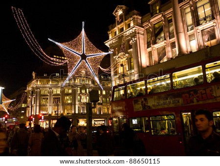 LONDON, UK-NOVEMBER 10: The annual christmas lights are strung across London's famous Oxford Street, to attract and encourage shoppers to the West End. November 10, 2011 in London UK. - stock photo