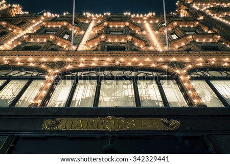 LONDON, UK - NOVEMBER 20, 2015: The famous Harrods department store in the evening of November, 2015 at Knightsbridge in London, UK. Harrods is the biggest department store in Europe - stock photo