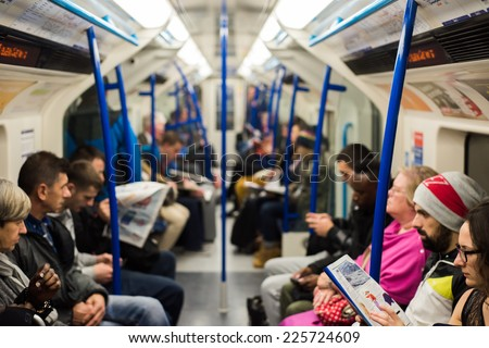 LONDON, UK - OCT 24: People sitting on a Victoria Line underground train in London on October 24, 2014. London Underground carried a record 1.26 billion passengers in the 2013-2014 year. - stock photo