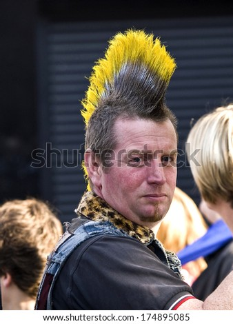 LONDON, UK - OCTOBER 23: An unidentified fan of rock and punk music at Camden Town  in London on October 23, 2011 in London UK  - stock photo