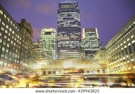 LONDON, UK - OCTOBER 17, 2015: Canary Wharf night view with traffic lights reflection