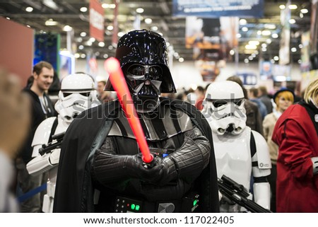 LONDON, UK - OCTOBER 28: Darth Vader and Storm Troopers pose at the London Comicon MCM Expo. Most participants dress up as superheroes for the Euro Cosplay Championship. October 28, 2012 in London. - stock photo