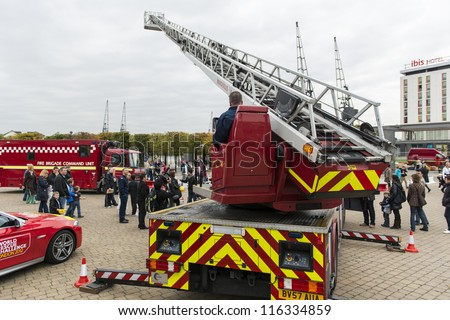 LONDON, UK - OCTOBER 20: Fire fighters from across the globe demonstrate their skills during the three days of the World rescue challenge. October 20, 2012 in London. - stock photo