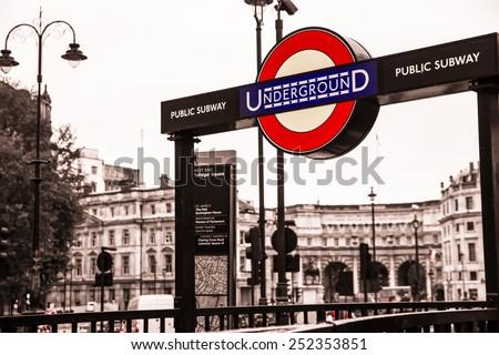 LONDON, UK - OCTOBER 9, 2014:  Iconic London Underground subway sign at Trafalgar Square.  - stock photo
