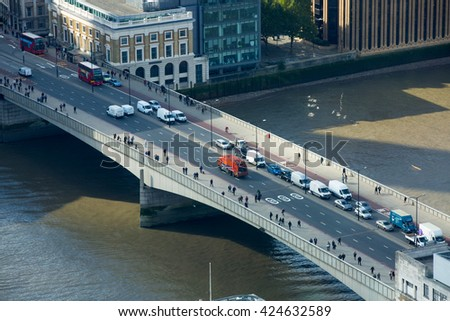 LONDON, UK - OCTOBER 14, 2015. London panorama, London bridge, transport and people walking across the bridge
