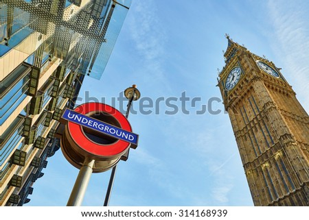 LONDON, UK - OCTOBER 31, 2014: London Underground subway sign in front of famous Clock Tower (now officially called the Elizabeth Tower) with bell Big Ben at Westminster in London.