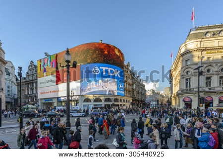 LONDON, UK - OCTOBER 11: Many people and traffic on Picadilly Circus on oct 11 2014 in London, United Kingdom, Europe - stock photo