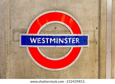 LONDON, UK - OCTOBER 17, 2014: Metro station sign Westminster on the District, Circle and Jubiilee line in London, UK, October 17, 2014.  - stock photo
