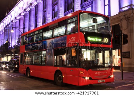 London, UK - October 6, 2011: No 10 London  red double decker bus at night, passing Selfridges Department Store in Oxford Street, on its journey across London to Warren Street - stock photo