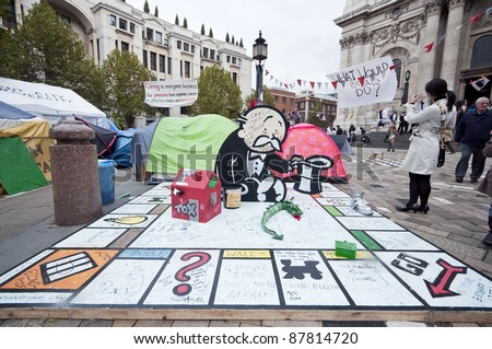 LONDON, UK -OCTOBER 31: Occupy London outside St.Paul's Cathedral with Banksy's donation to protesters on October 31, 2011 in London. - stock photo