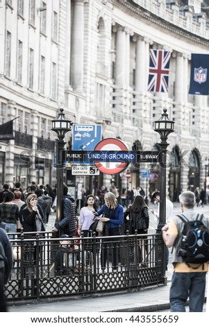 LONDON, UK - OCTOBER 4, 2015: Piccadilly circus underground station entrance with lots people walking by
