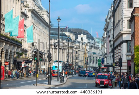 LONDON, UK - OCTOBER 4, 2015: Piccadilly street with lot of walking people, pedestrians and public transport, cars, taxis on the road. - stock photo