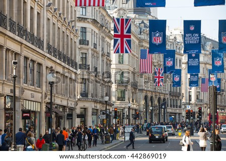 LONDON, UK - OCTOBER 4, 2015: Regent street with lot of walking people, shopping at west end and public transport, taxis, cars and buses