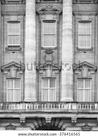 LONDON, UK - OCTOBER 4, 2016: Royal balcony,  Buckingham palace is the residence of queen Elizabeth II the monarch of the United Kingdom. Square with lots of tourist and city visitors  - stock photo