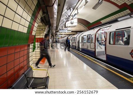 LONDON, UK - OCTOBER 8, 2014:  View of London Underground at the Piccadilly Station with passengers visible.