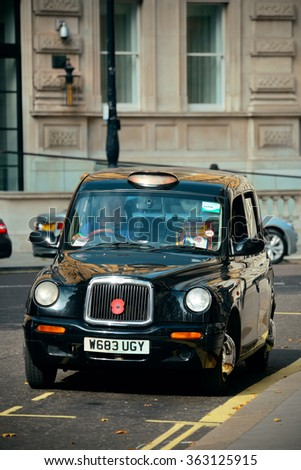 LONDON, UK - SEP 27: London Street view with vintage taxi on September 27, 2013 in London, UK. London is the world's most visited city and the capital of UK. - stock photo