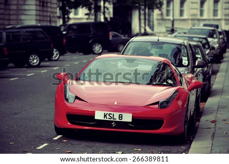 LONDON, UK - SEP 27: Red Ferrari and London Street view on September 27, 2013 in London, UK. London is the world's most visited city and the capital of UK. - stock photo