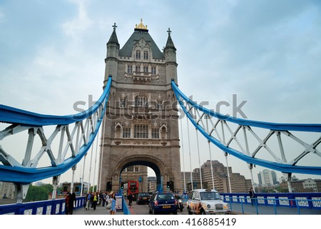 LONDON, UK - SEP 25: Tower Bridge with tourists and traffic on September 25, 2013 in London, UK. It is one of the iconic architectures in London and one of the most famous bridges in the world. - stock photo