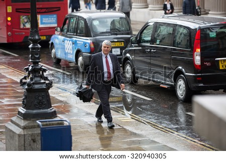 LONDON, UK - SEPTEMBER 17, 2015: Businessmen walking on the Bank street - stock photo