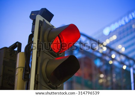 LONDON, UK - 7 SEPTEMBER, 2015: Canary Wharf traffic lights showing red  - stock photo