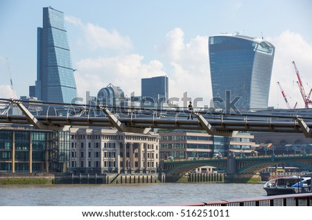 LONDON UK - SEPTEMBER 10, 2015 - City of London modern business aria view from the London Bridge.