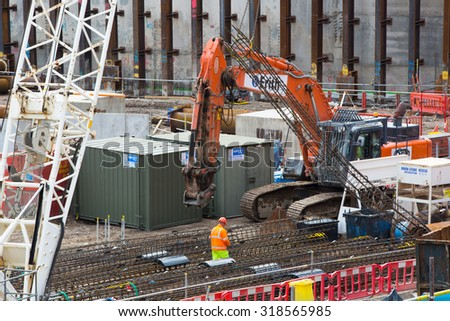LONDON, UK - SEPTEMBER 17, 2015: Crane and building construction site, Holborn aria - stock photo