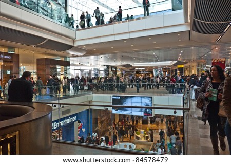 LONDON, UK- SEPTEMBER 13: Crowds of shoppers on the opening day of Westfield Stratford City, the largest urban shopping centre in Europe, and gateway to the Olympic Park. September 13, 2011 London UK - stock photo