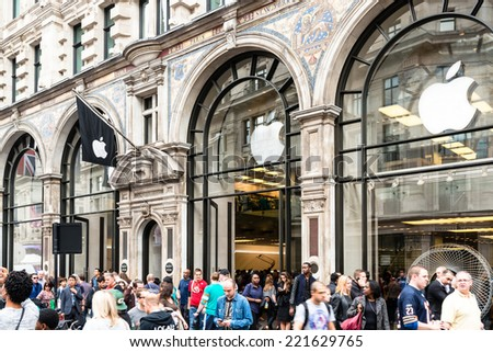 LONDON, UK - SEPTEMBER 27, 2014: Customers are populating the Apple Inc. store in Regent Street in order to admire the new Apple iPhone 6 and iPhone 6 Plus on September 27, 2014 in London, UK. - stock photo