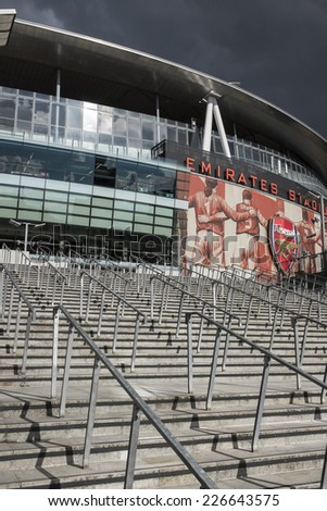 LONDON, UK - SEPTEMBER 24, 2014 : Emirates Stadium, North London, home of English Premier League team Arsenal Football Club. View shows steps leading up to the south entrance and Clock End.