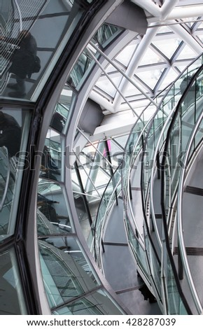 LONDON, UK - SEPTEMBER 19, 2016: Famous spiral staircases of London City Hall with walking people. Modern architectural structure